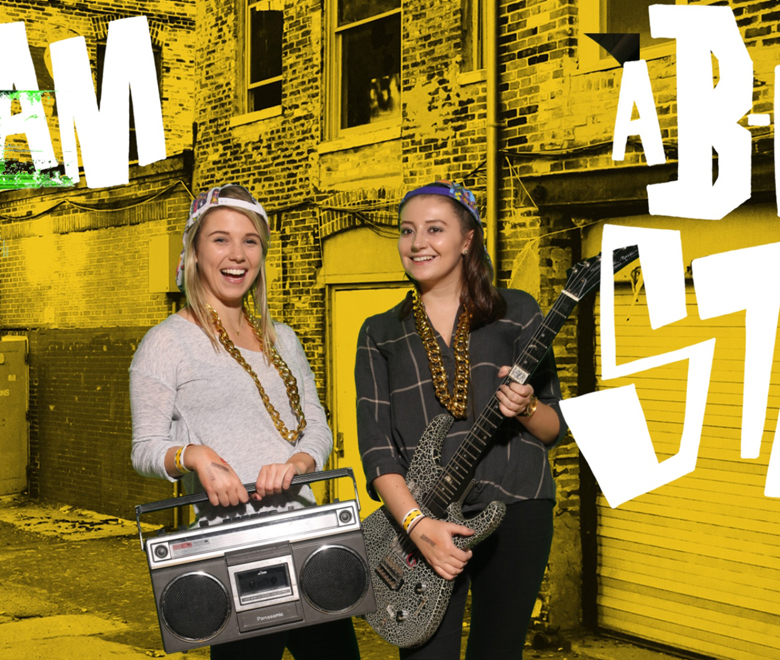 Two girls stood holding a stereo and guitar for Green Screen Background Ideas