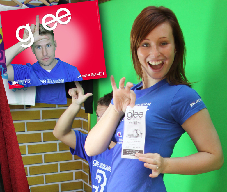 Woman posing in Glee green screen photo booth