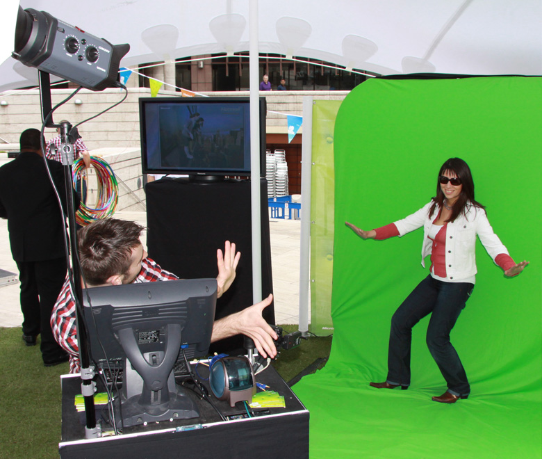 Woman posing in front of green screen