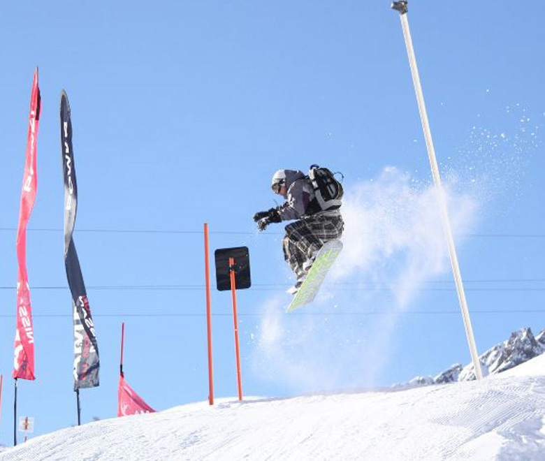 Man jumping through the air at Nissan skiing event