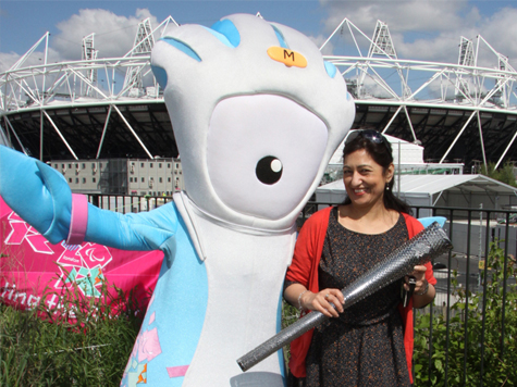 Woman posing with mascot and torch at London 2012 Olympics