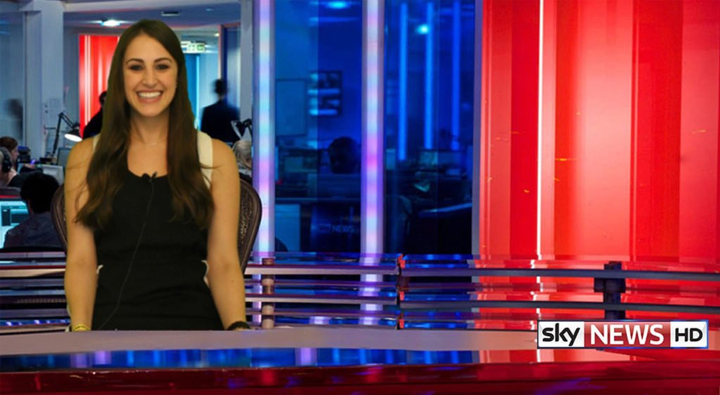 Woman smiling in front of Sky News green screen