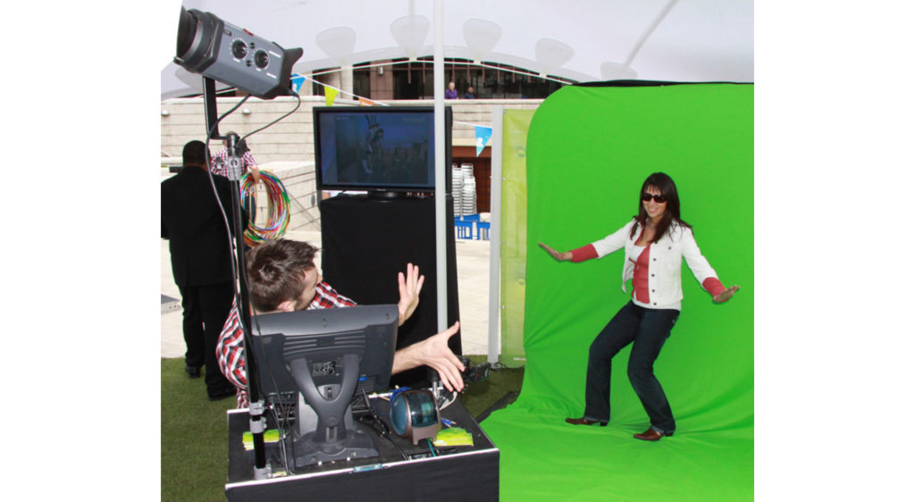 Woman posing in front of a green screen set up