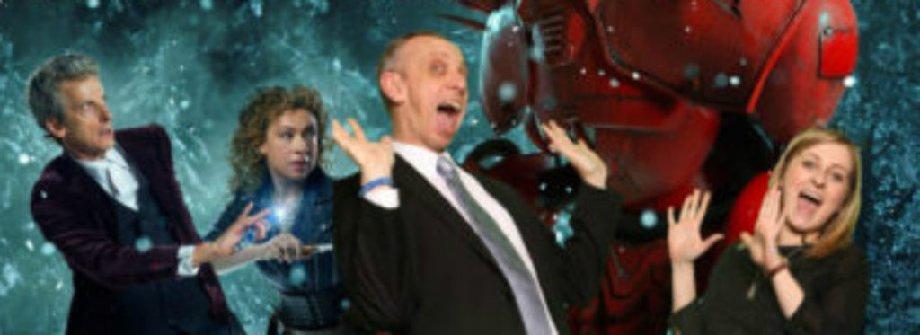 Two people posing with Dr Who green screen backdrop