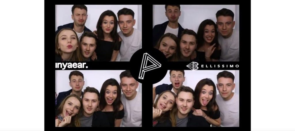 Group posing for nightclub photography in photo booth