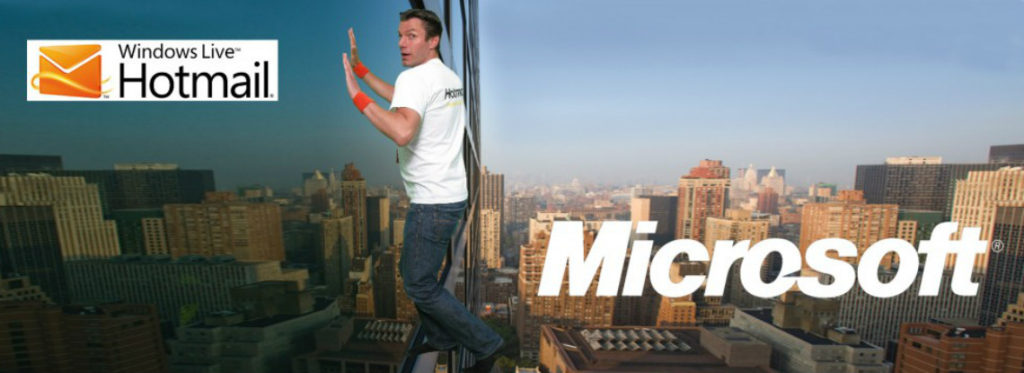 Man scaling tall building with green screen photography