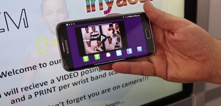 Smartphone accessing microsite to download social media photo booth images
