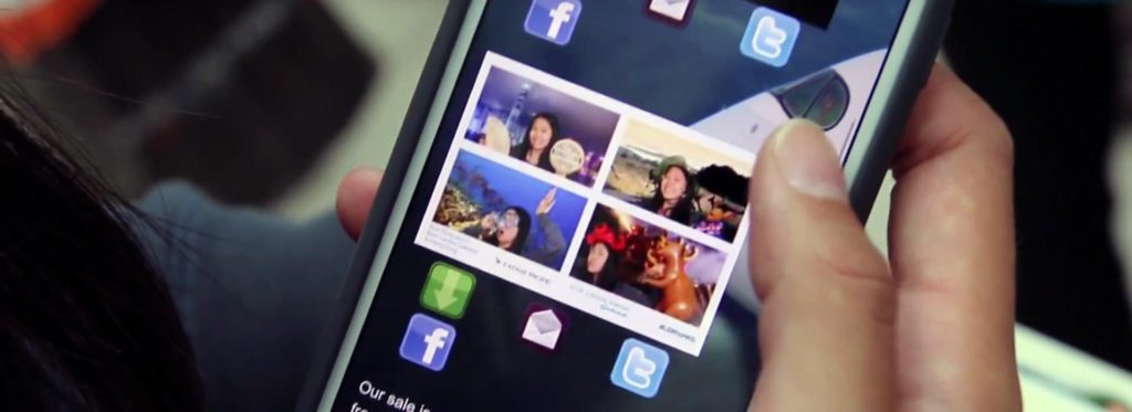 view of smartphone accessing images from a social media photo booth