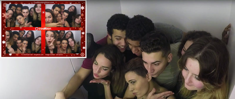 Group gathered in photo booth for at christmas party