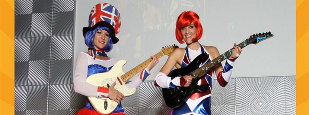Green screen photo booth props including guitars and wigs