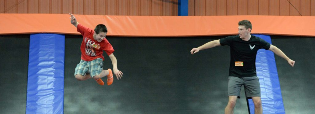 Boys jumping up and down at a trampoline park