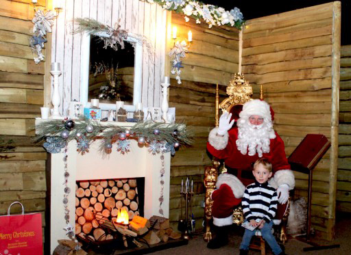Little boy visiting santa's grotto